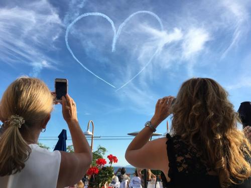 """Diana Mayhew & Stefania Carlin watch The Royal Canadian Air Force Snowbirds perform for CH.I.L.D. Foundation"" Photo by Doug Mayhew"