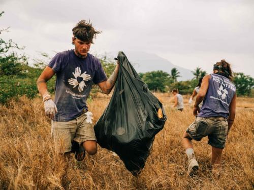 """Volunteers Help a Community"" Photo by Michael Demas"